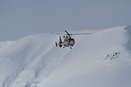 Sysselmannen helicopter patrols northernmost ski marathon in the world outside Longyearbyen on Spitsbergen island in April; Svalbard, Norway.