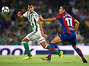 SEVILLE, SPAIN - SEPTEMBER 25:  Aissa Mandi of Real Betis Balompie (L) being followed by Alex Alegria of Levante UD (R) during the La Liga match between Real Betis and Levante at Estadio Benito Villamarin on September 25, 2017 in Seville, .  (Photo by Aitor Alcalde Colomer/Getty Images)