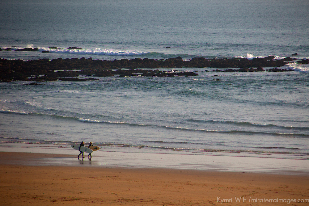 Europe, United Kingdom, Wales, Pembrokeshire. Surfers on shore at Freshwater West Beach.