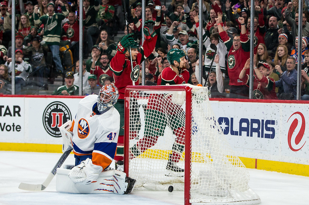 Dec 29, 2016; Saint Paul, MN, USA; Minnesota Wild forward Chris Stewart (7) scores a goal as forward Jason Pominville (29) celebrates in front of New York Islanders goalie Jaroslav Halak (41) during the second period at Xcel Energy Center. Mandatory Credit: Brace Hemmelgarn-USA TODAY Sports