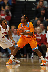 Dec 20, 2011; Stanford CA, USA; Tennessee Lady Volunteers guard Ariel Massengale (5) is defended by Stanford Cardinal guard Amber Orrange (33) during the second half at Maples Pavilion.  Stanford defeated Tennessee 97-80. Mandatory Credit: Jason O. Watson-US PRESSWIRE