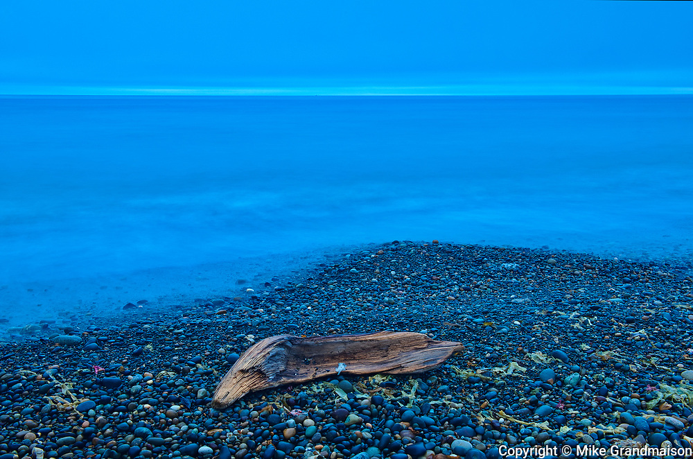 Driftwood on Agate Beach at dusk. Pacific Ocean. Naikoon Provincial Park. Graham Island. , Haida Gwaii (formerly the Queen Charlotte Islands), British Columbia, Canada