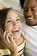 Girl Laughing While Using Cell Phone