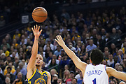 January 31, 2019; Oakland, CA, USA; Golden State Warriors guard Stephen Curry (30) shoots the basketball against Philadelphia 76ers guard Landry Shamet (1) during the fourth quarter at Oracle Arena.