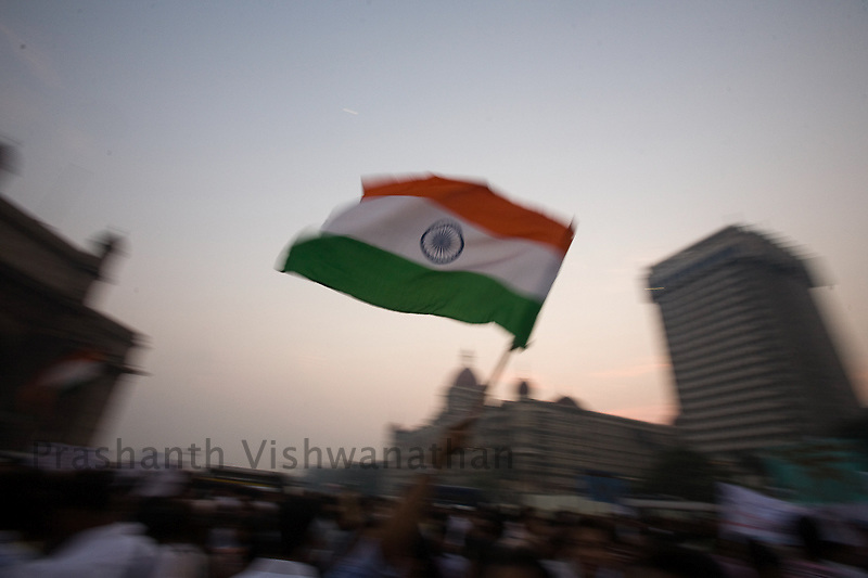 Indian men women and  children gather in larger numbers shouting anti political slogans and singing the national anthem during a vigil held for the victims of the Mumbai terror attacks, in Mumbai December 3, 2008.