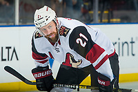 KELOWNA, BC - SEPTEMBER 29:  Derek Stepan #21 of the Arizona Coyotes lines up against the Vancouver Canucks at Prospera Place on September 29, 2018 in Kelowna, Canada. (Photo by Marissa Baecker/NHLI via Getty Images)  *** Local Caption *** Derek Stepan