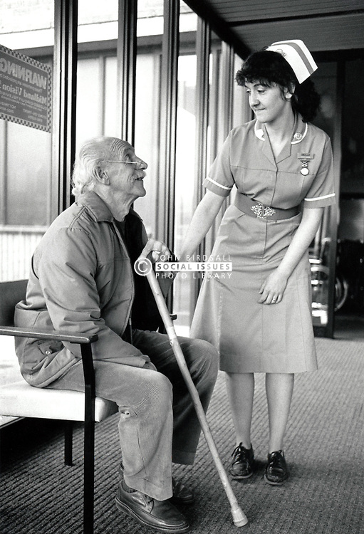 Nurse & elderly man, Queen's Medical Centre hospital, Nottingham March 1989 UK
