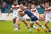 Bradford Bulls replacement Mikolaj Oledzki (31) breaks the tackle of Swinton Lions Anthony Nicholson (9) to score a try  during the Kingstone Press Championship match between Swinton Lions and Bradford Bulls at the Willows, Salford, United Kingdom on 20 August 2017. Photo by Simon Davies.