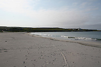 Sandy blue flag beach on the Aran Islands County Galway Ireland