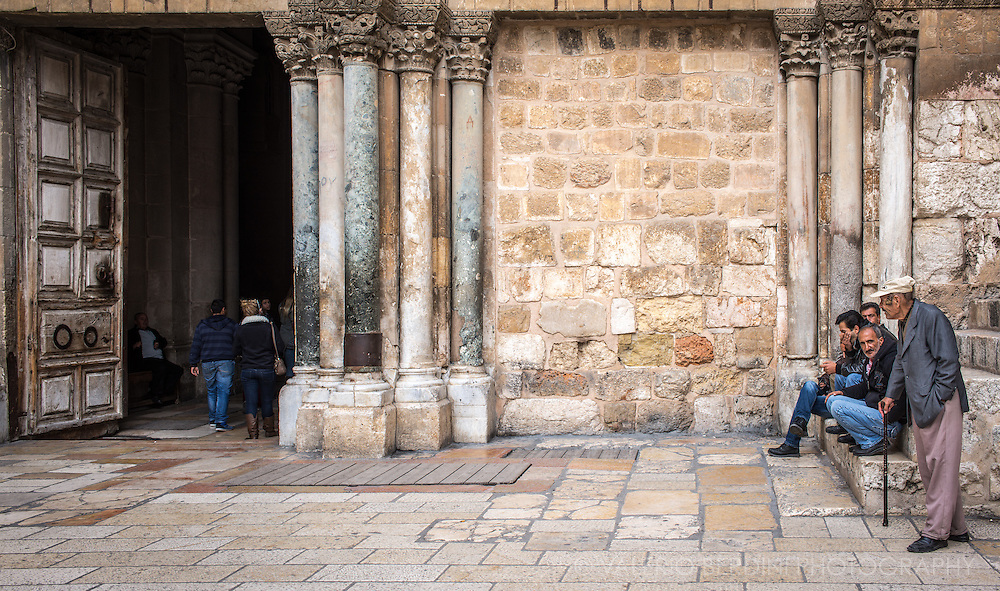 Beggars at the entrance of the church of the Holy Sepulchre in the Old City of Jerusalem. The site where Jesus was crucified, buried and resuscitated is worshipped as the holiest site for Christianity.