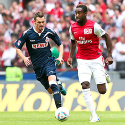 23.07.2011,  Rhein Energie Stadion, Koeln, GER, FSP, 1. FC Koeln vs Arsenal London, im Bild:  Milivoje Novakovic (Koeln #11) (L)  gegen Johan Djourou (Arsenal #20) (R) ..// during the friendly match, 1. FC Koeln vs Arsenal London on 2011/07/23, Rhein-Energie Stadion, Köln, Germany. EXPA Pictures © 2011, PhotoCredit: EXPA/ nph/  Mueller *** Local Caption ***       ****** out of GER / CRO  / BEL ******
