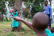 At Nyamiyaga primary school the Bwindi Community Hospital run health outreach programs. Reverend Sam, Head of Community Health works on a sight test game with the children. As part of the outreach programme they cover 32 primary schools and 5 secondary schools in the region as well as many communities. The main Bwindi Community Hospital is in Buhoma village on the edge of the Bwindi Impenetrable Forest in Western Uganda. It serves around 250,000 people from the surrounding area.