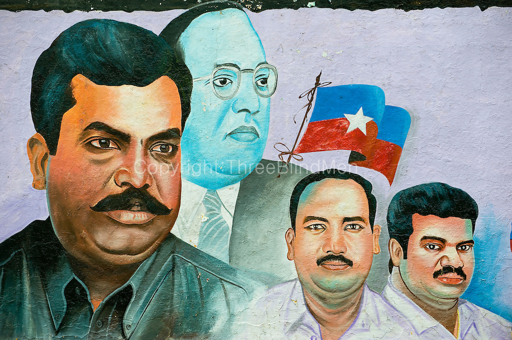 Painted wall mural of local South India politicians.