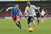 Jamie Ness of Scunthorpe United , Marvin Sordell of colchester United during the Sky Bet League 1 match between Scunthorpe United and Colchester United at Glanford Park, Scunthorpe, England on 23 January 2016. Photo by Ian Lyall.