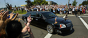Supporters and protesters alike line the street in a farewell to President George W. Bush who made a campaign stop at Southridge High School in Beaverton. the unhappy ones jeered and shouted insults, others flipped him off with the bird.""