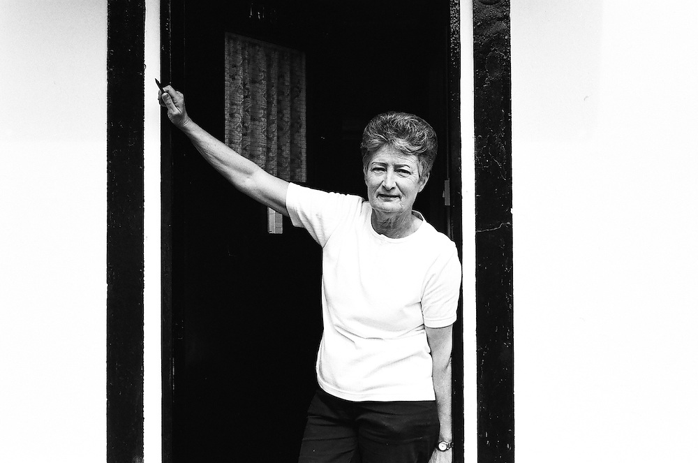 Alice outside her uni-seco Prefab in Nunhead, 2002. Post-war prefabs in Peckham, Nunhead, Dulwich, South London in 2002 and 2003