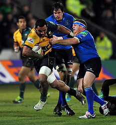 Samu Manoa (Northampton) takes on the Leinster defence - Photo mandatory by-line: Patrick Khachfe/JMP - Tel: Mobile: 07966 386802 07/12/2013 - SPORT - RUGBY UNION -  Franklin's Gardens, Northampton - Northampton Saints v Leinster - Heineken Cup.