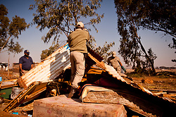 South Africa – Johannesburg – Nanas Farm N12. A large group of land seekers gather on Nanas farm near Avalon cemetery along the N12 in Soweto. They are occupying land which they say should be given to them as the city is failing them with housing.  Metro police came in and demolished the illegal structures causing havoc. The drama unfolded near the highway causing traffic concerns. The land seekers say they will stay her and rebuild their houses. Picture: Timothy Bernard/African News Agency(ANA)