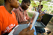 Abass Aryee (L) and Oti Dodoo use laptops to browse the internet over a wireless network at the Kokrobitey Institute in the town of Kokrobitey, 30km west of Ghana's capital Accra on Sunday January 18, 2009.