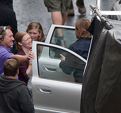 """Brad Pitt and co-star Mireille Enos the set of the movie """"World War Z"""" being shot in the city centre of Glasgow. The film, which is set in Philadelphia, is being shot in various parts of Glasgow, transforming it to shoot the post apocalyptic zombie film."""