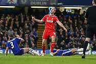 Jordan Henderson of Liverpool (centre) shows his frustration at missing a chance while Filipe Luis of Chelsea (left) and John Terry of Chelsea (right) lay on the floor during the Capital One Cup Semi Final 2nd Leg match between Chelsea and Liverpool at Stamford Bridge, London, England on 27 January 2015. Photo by David Horn.