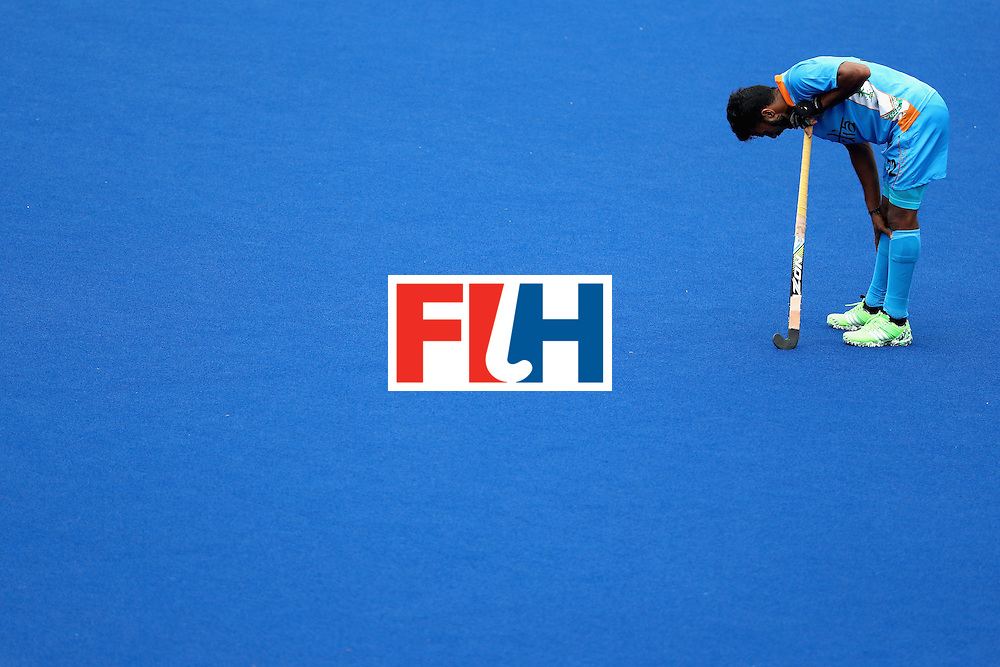 RIO DE JANEIRO, BRAZIL - AUGUST 12:  Raghunath Vokkaliga #12 of India  of India slumps during a break against Canada during a Men's Preliminary Pool B match on Day 7 of the Rio 2016 Olympic Games at the Olympic Hockey Centre on August 12, 2016 in Rio de Janeiro, Brazil.  (Photo by Sean M. Haffey/Getty Images)