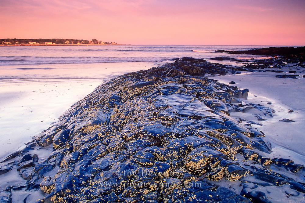 Low tide on a beach in Kennebunkport, Maine at sunset