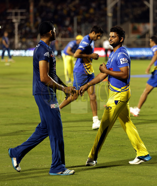 Harbhajan Singh of the Mumbai Indians  and Suresh Raina of The Chennai Superkings  before the eliminator match of the Pepsi Indian Premier League Season 2014 between the Chennai Superkings and the Mumbai Indians held at the Brabourne Stadium, Mumbai, India on the 28th May  2014<br /> <br /> Photo by Sandeep Shetty / IPL / SPORTZPICS<br /> <br /> <br /> <br /> Image use subject to terms and conditions which can be found here:  http://sportzpics.photoshelter.com/gallery/Pepsi-IPL-Image-terms-and-conditions/G00004VW1IVJ.gB0/C0000TScjhBM6ikg