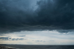 © Licensed to London News Pictures. <br /> 08/06/2014. <br /> <br /> Saltburn, United Kingdom<br /> <br /> Dark and brooding thunder clouds form over Saltburn, Cleveland.<br /> <br /> Photo credit : Ian Forsyth/LNP