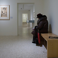 VENICE, ITALY - JANUARY 28:  A visitor at the Peggy Guggenheim Collection reads the catalogue next to one of the exhibits at the press launch of the Vorticist exhibition on January 28, 2011 in Venice, Italy. The Vorticists: Rebel Artists in London and New York, 1914-1918, is the first exhibition devoted to Vorticism to be presented in Italy will be open at the Peggy Guggenheim Collection from  January 29 through May 15, 2011.