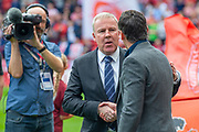 Manager of Portsmouth FC, Kenny Jackett shakes hands with Sunderland AFC manager, Jack Ross before the EFL Sky Bet League 1 match between Sunderland and Portsmouth at the Stadium Of Light, Sunderland, England on 17 August 2019.