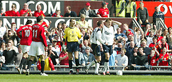 MANCHESTER, ENGLAND - Saturday, April 5, 2003: Liverpool's Igor Biscan holds his head in his hands after conceeding a penalty to Manchester United despite being outside the penalty area during the Premiership match at Old Trafford. (Pic by David Rawcliffe/Propaganda)