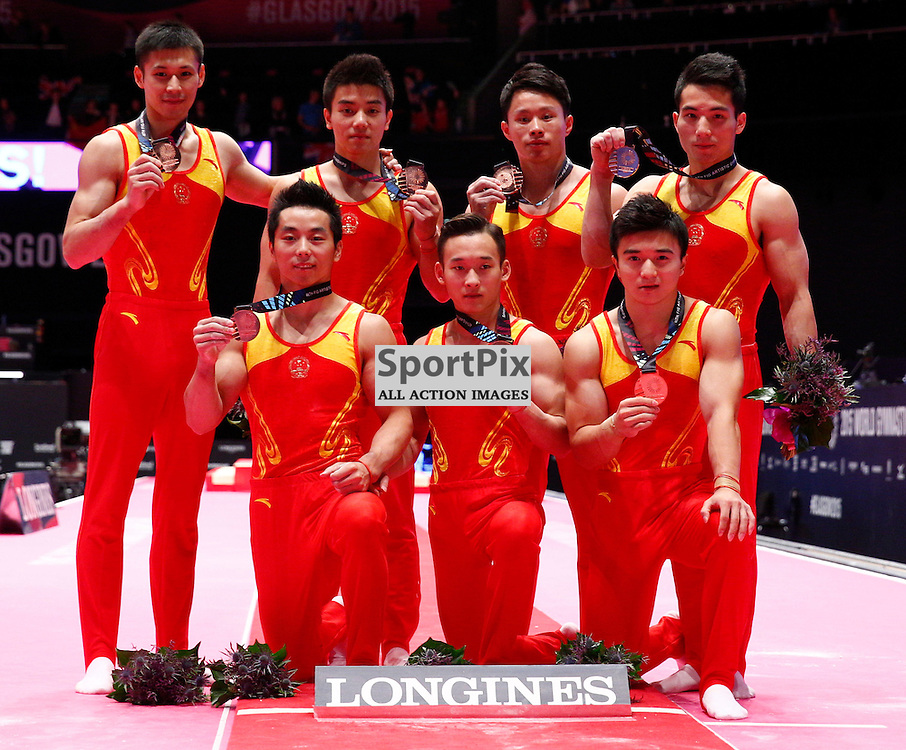 2015 Artistic Gymnastics World Championships being held in Glasgow from 23rd October to 1st November 2015....The team from The Peoples Republic of China celebrate winning bronze in the Men's Team Final...(c) STEPHEN LAWSON | SportPix.org.uk