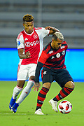 Flamengo forward Miguel Trauco (13) and Ajax forward David Neres (7) in action during a Florida Cup match at Orlando City Stadium on Jan. 10, 2019 in Orlando, Florida. <br /> Flamengo won in penalties 4-3.<br /> <br /> ©2019 Scott A. Miller
