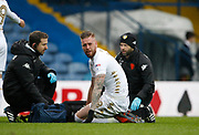 Leeds United defender Pontus Jansson (18) receives treatment during the EFL Sky Bet Championship match between Leeds United and Cardiff City at Elland Road, Leeds, England on 3 February 2018. Picture by Paul Thompson.
