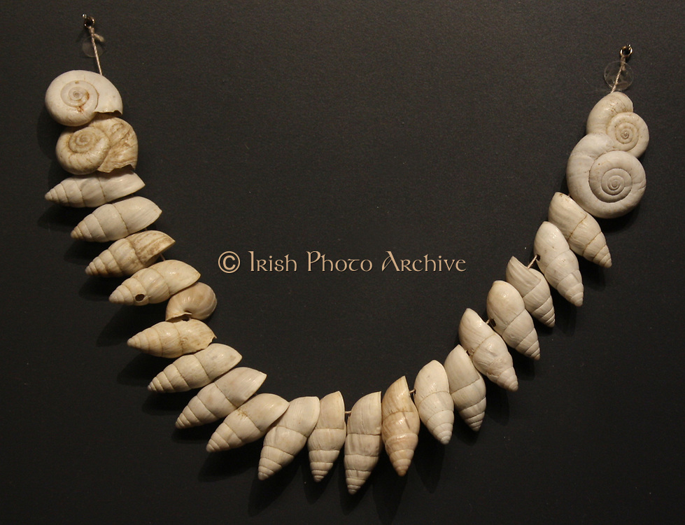 Snail shell beads, about 8000years ago.