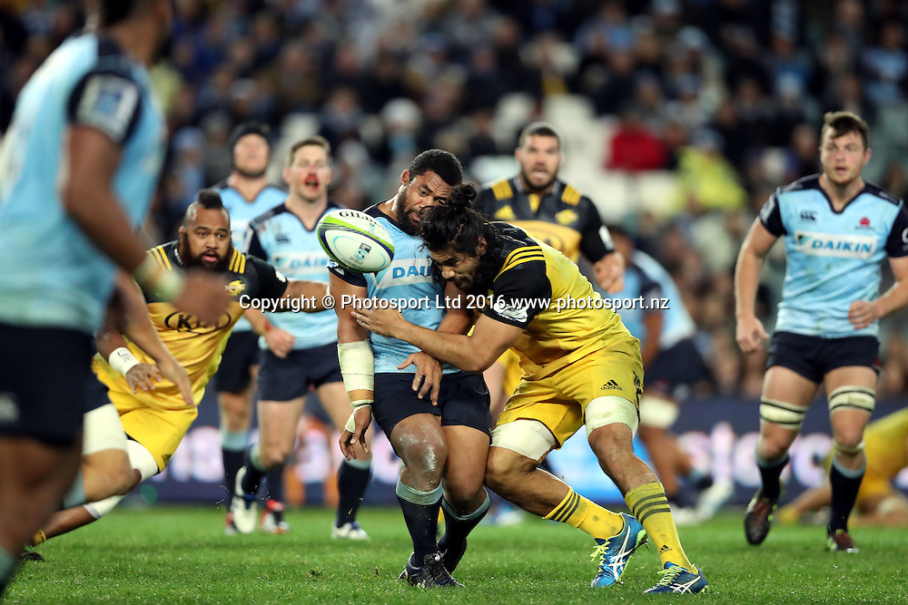Tatafu Polota Nau tackled by Michael Fatialofa<br /> Super Rugby union match, Waratahs vs Hurricanes, Sydney, Australia. Saturday 9 July 2016. Photo: Paul Seiser / www.photosport.co.nz