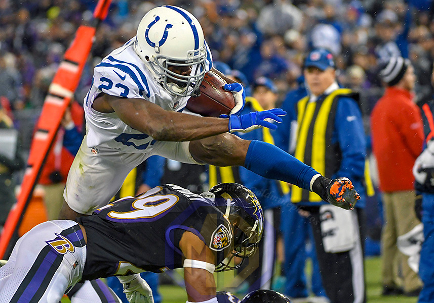 BALTIMORE, MD - DECEMBER 23: Indianapolis Colts running back Frank Gore (23) hurdles Baltimore Ravens defensive back Marlon Humphrey (29) to a score a second quarter touchdown on a 14-yard touchdown reception on December 23, 2017, at M&T Bank Stadium in Baltimore, MD. (Photo by Mark Goldman/Icon Sportswire)