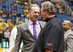 Jan 7, 2017; Morgantown, WV, USA; TCU Horned Frogs head coach Jamie Dixon talks with West Virginia Mountaineers head coach Bob Huggins before their game at WVU Coliseum. Mandatory Credit: Ben Queen-USA TODAY Sports