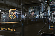 London, England, UK, September 6 2018 - Maciej Boczek, a 29 yo driver of UPS company, is about to drive an electric vehicle at UPS central London site in Kentish Town.<br /> A UPS led consortium with UK Power Networks Services and Cross River Partnership has deployed a new charging technology in London that overcomes the challenge of simultaneously recharging an entire fleet of electric vehicles (EVs) without the need for the expensive upgrade to the power supply grid. The technology, based on the use of onsite energy storage batteries, is now used to provide extra energy needed during peak hours, but it should also allow to increase the number of EVs operating from UPS central London site from the current limit of 65 to all 170 trucks based there.