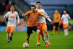 Wolves Midfielder Slawomir Peszko (POL) vies with Blackpool Midfielder Tiago Gomes (POR) during the second half of the match - Photo mandatory by-line: Rogan Thomson/JMP - Tel: Mobile: 07966 386802 26/01/2013 - SPORT - FOOTBALL - Molineux Stadium - Wolverhampton. Wolverhampton Wonderers v Blackpool - npower Championship.