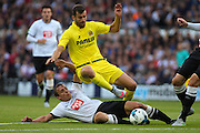 Stephen Warnock wins a crunching tackle from Villarreal's Leonardo Carrilho Baptistao during the Pre-Season Friendly match between Derby County and Villarreal CF at the iPro Stadium, Derby, England on 29 July 2015. Photo by Aaron Lupton.