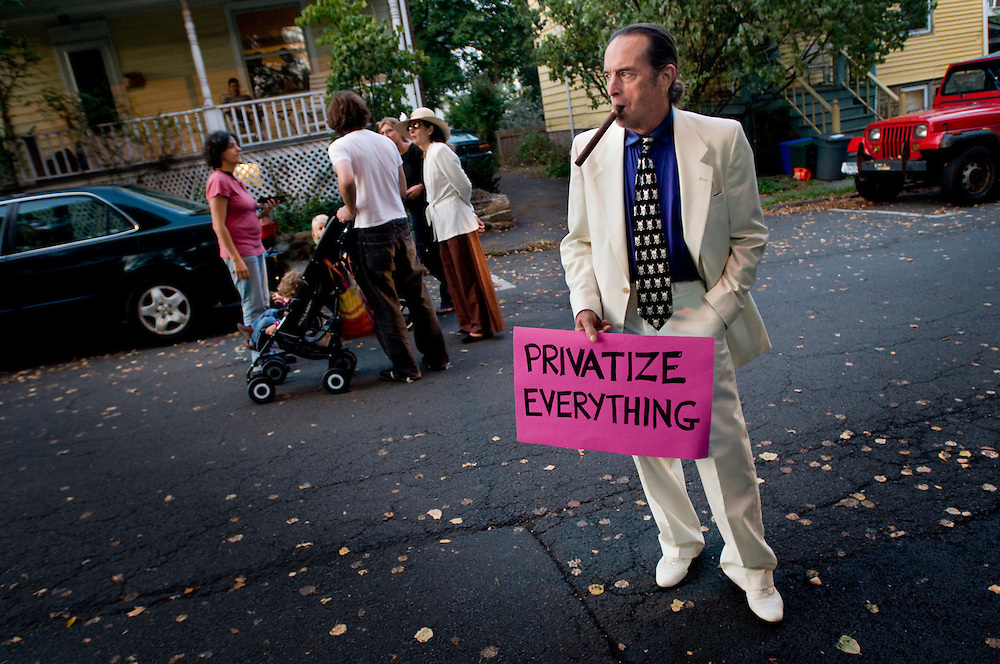 Rally for healthcare reform in Nyack, New York - a supporter of the reform, ironically dressed as a rich man who wants to privatize everything..Photographer: Chris Maluszynski /MOMENT