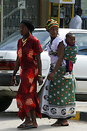Women and a baby in the streets of Dar es Salaam, Tanzania.