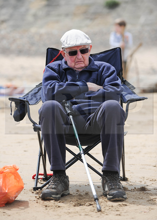 © Licensed to London News Pictures. 27/05/2013..Saltburn, England..A man snoozes on the beach during warm bank holiday weather at Saltburn by the Sea in Cleveland....Photo credit : Ian Forsyth/LNP