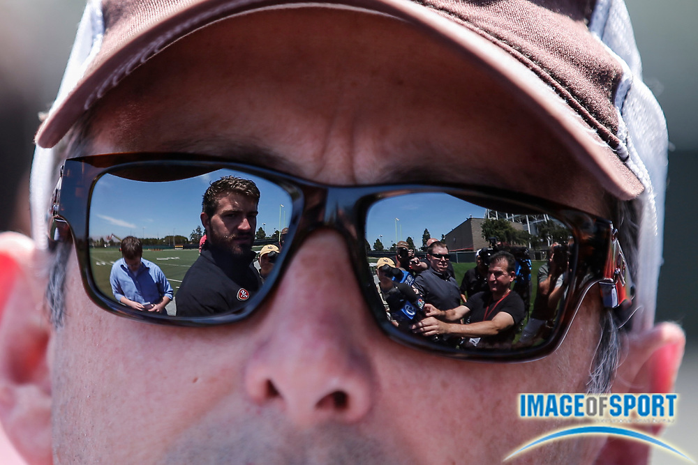 May 23, 2014; Santa Clara, CA, USA; San Francisco 49ers quarterback Kory Faulkner (left), reflected in the glasses of reporter Matt Maiocco, addresses the media prior to rookie minicamp at the 49ers training facility.