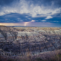 montana badlands lighting and huge storm clouds over badlands conservation photography - montana wild prairie