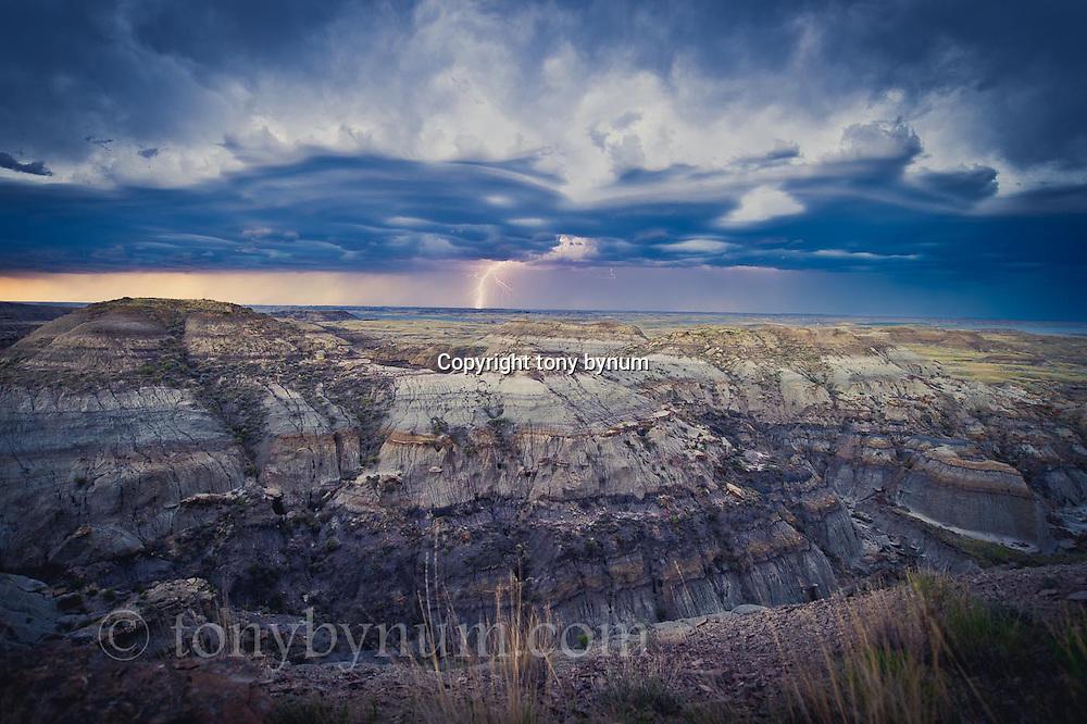 montana badlands lighting and huge storm clouds over badlands conservation photography - montana wild prairie