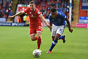 Oldham Athletic striker Aaron Amadi-Holloway (10) battles for possession with Walsall midfielder Shaun Donnellan (23) 0-0 during the EFL Sky Bet League 1 match between Walsall and Oldham Athletic at the Banks's Stadium, Walsall, England on 12 August 2017. Photo by Alan Franklin.