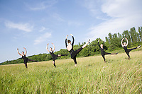 Young women dance in a field